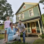 BEAU CABELL/THE TELEGRAPH Macon, Ga., 08/20/2014:  Craig Byron and wife, Ellen, and their daughters, Julia, 7, and Grace, 10, in front of the family's renovated home on Ash Street.